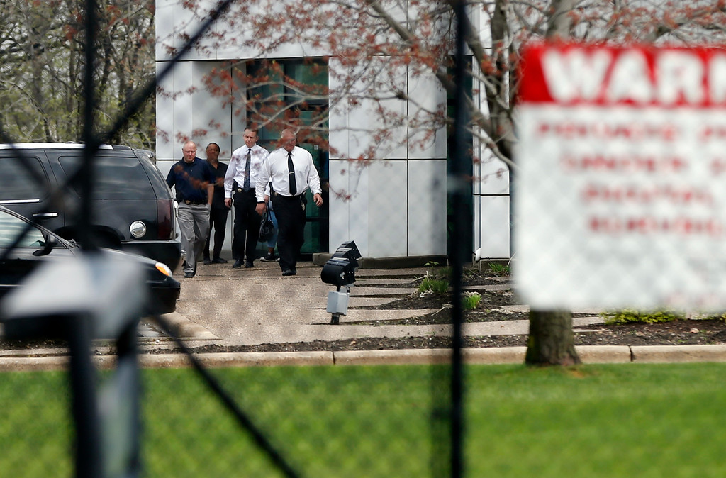 . Law enforcement personnel walk outside at Paisley Park Studios, the home and studio of singer Prince, Thursday, April 21, 2016 in Chanhassen, Minn. Prince died at the home, Thursday, at the age of 57. (AP Photo/Jim Mone)