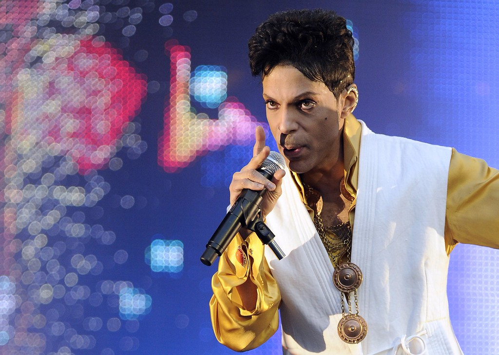 . US singer and musician Prince (born Prince Rogers Nelson) performs on stage at the Stade de France in Saint-Denis, outside Paris, on June 30, 2011.  Prince\'s publicist has confirmed that Prince died at his his home in Minnesota, Thursday, April 21, 2016. He was 57. (BERTRAND GUAY/AFP/Getty Images)