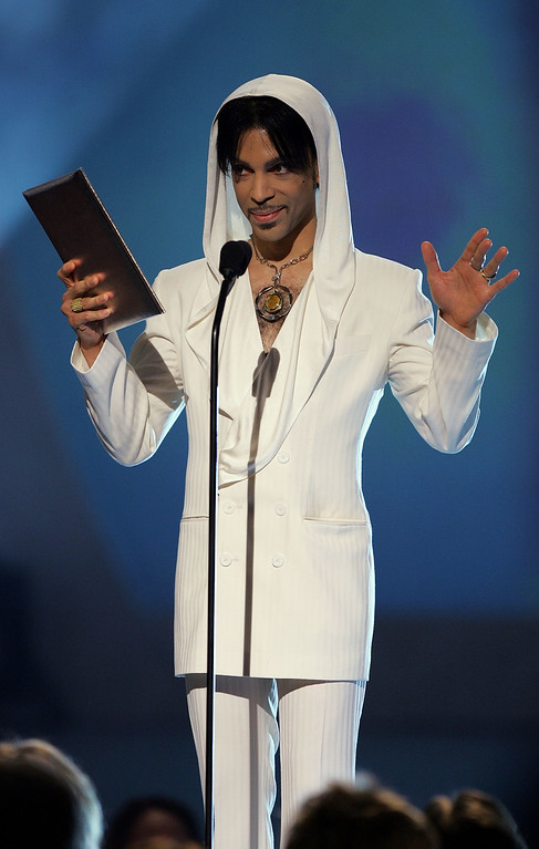 """. PASADENA, CA - JANUARY 9:  Musician Prince presents the award for \""""Favorite Leading Lady\"""" onstage during the 31st Annual People\'s Choice Awards at the Pasadena Civic Auditorium on January 9, 2005 in Pasadena, California. (Photo by Frank Micelotta/Getty Images)"""