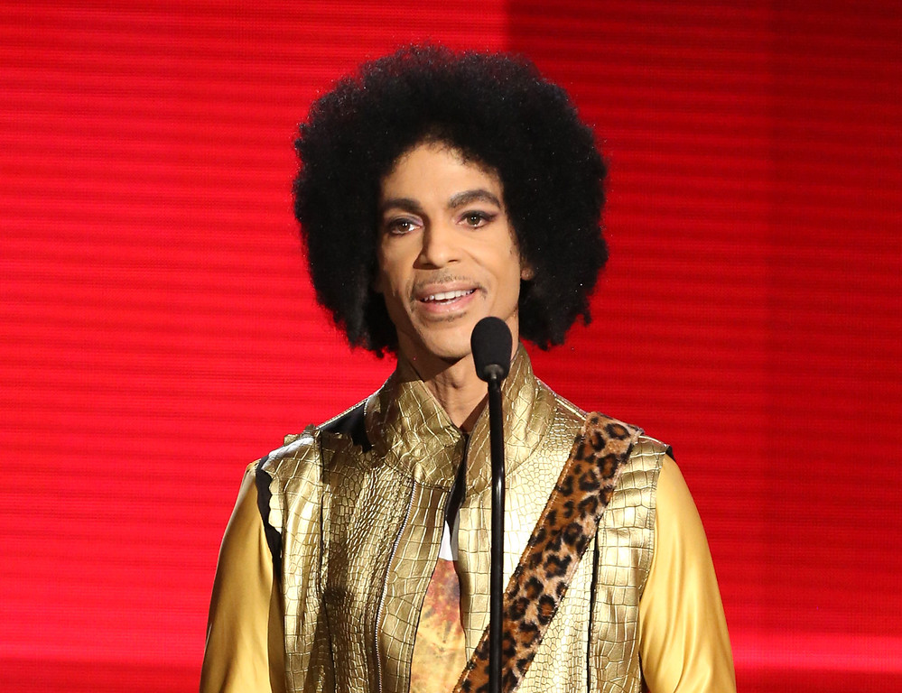 . FILE - In this Nov. 22, 2015 file photo, Prince presents the award for favorite album - soul/R&B at the American Music Awards in Los Angeles. Prince died at his home in Minnesota, Thursday, April 21, 2016. He was 57.   (Photo by Matt Sayles/Invision/AP, File)