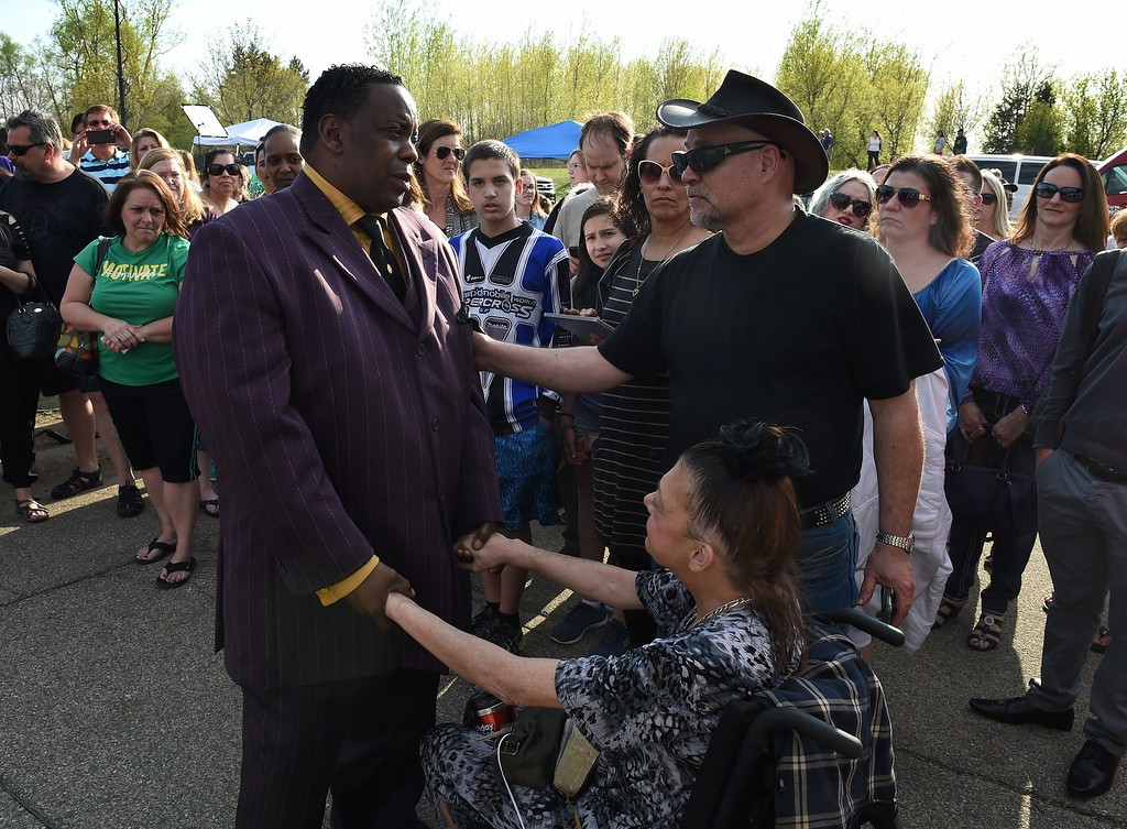 . Maurice Phillips (L), the brother-in-law of Prince, talks with fans following a memorial service held inside the Paisley Park compound of music legend Prince, who died suddenly at the age of 57,  in Minneapolis, Minnesota, on April 23, 2016. Family, friends and musicians attended the service after the remains of Prince were cremated before being placed in a private location. (MARK RALSTON/AFP/Getty Images)