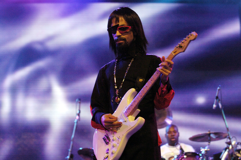. NEW ORLEANS - JULY 2: American musician Prince wears a wig, sunglasses, and a false goatee as a disguise with the opening act of The 10th Anniversary Essence Music Festival on July 2, 2004 in New Orleans, Louisiana. (Photo by Chris Graythen/Getty Images)