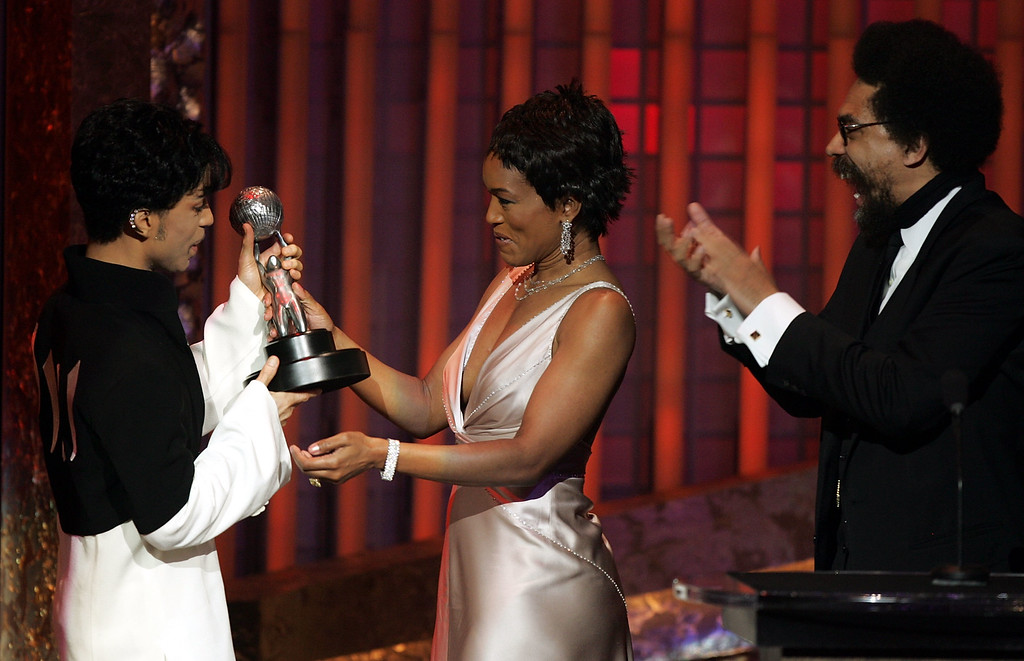 . LOS ANGELES, CA - MARCH 19:  Musician Prince is seen accepting the Vanguard Award from actress Angela Bassett and Dr. Cornel West on stage at the 36th NAACP Image Awards at the Dorothy Chandler Pavilion on March 19, 2005 in Los Angeles, California.  (Photo by Kevin Winter/Getty Images)