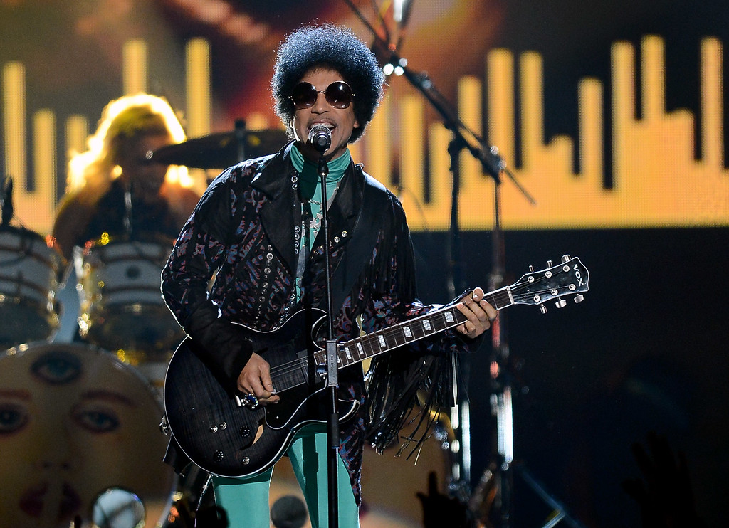 . LAS VEGAS, NV - MAY 19:  Recording artist Prince performs during the 2013 Billboard Music Awards at the MGM Grand Garden Arena on May 19, 2013 in Las Vegas, Nevada.  (Photo by Ethan Miller/Getty Images)