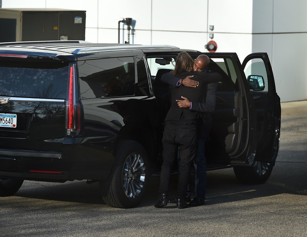 . Guests console each other April 23, 2016 following a memorial service inside the Paisley Park compound of music legend Prince, who died suddenly at the age of 57, in Minneapolis, Minnesota.  Family, friends and musicians attended the service after the remains of Prince were cremated before being placed in a private location. (MARK RALSTON/AFP/Getty Images)