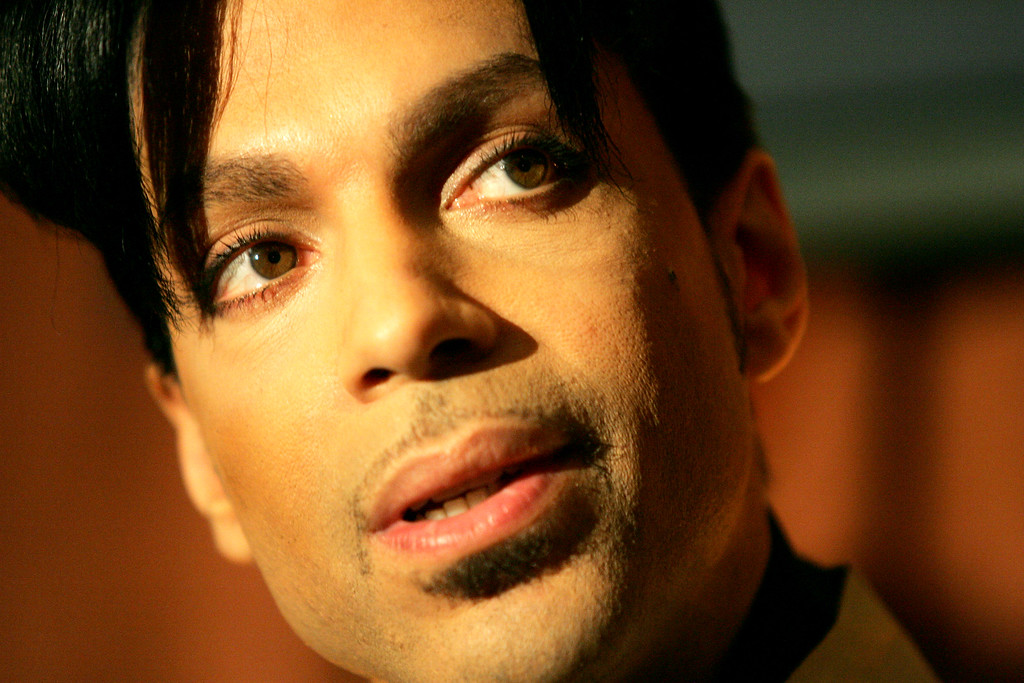 """. Recording artist Prince speaks during a news conference about his recording agreement between himself and Universal Records and his new single \""""Te Amo Corazon,\"""" Tuesday, Dec. 13, 2005, in Beverly Hills, Calif. Prince\'s new album \""""3121\"""" will be his first with Universal Records with a scheduled release in 2006. (AP Photo/Danny Moloshok)"""