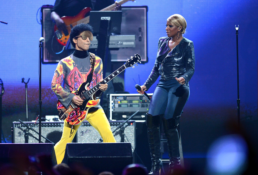 . Recording artist Prince (L) and singer Mary J. Blige perform onstage during the 2012 iHeartRadio Music Festival at the MGM Grand Garden Arena on September 22, 2012 in Las Vegas, Nevada.  (Photo by Isaac Brekken/Getty Images for Clear Channel)