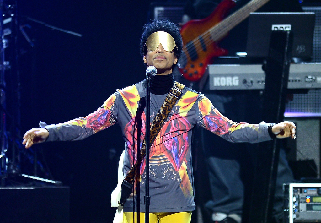 . Recording artist Prince performs with singer Mary J. Blige onstage during the 2012 iHeartRadio Music Festival at the MGM Grand Garden Arena on September 22, 2012 in Las Vegas, Nevada.  (Photo by Isaac Brekken/Getty Images for Clear Channel)