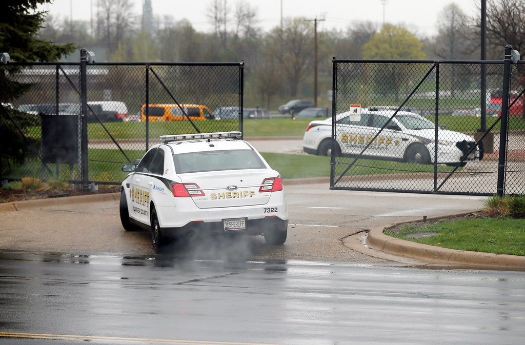 """. A police car enters Paisley Park Studios, the home and studio of singer Prince, on Thursday, April 21, 2016 in Chanhassen, Minn. Prince, widely acclaimed as one of the most inventive and influential musicians of his era with hits including \""""Little Red Corvette,\"""" \'\'Let\'s Go Crazy\"""" and \""""When Doves Cry,\"""" was found dead at his home on Thursday, according to his publicist. He was 57. (AP Photo/Jim Mone)"""