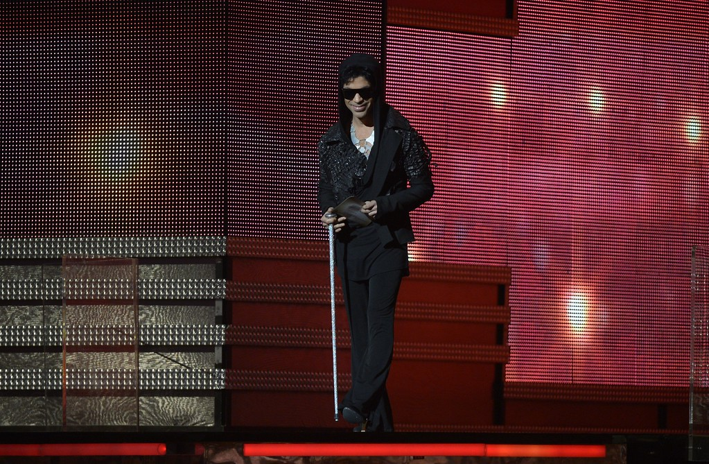 . Musician Prince arrives to present the winner for Record of the Year on stage at the Staples Center during the 55th Grammy Awards in Los Angeles, California, February 10, 2013.  (JOE KLAMAR/AFP/Getty Images)