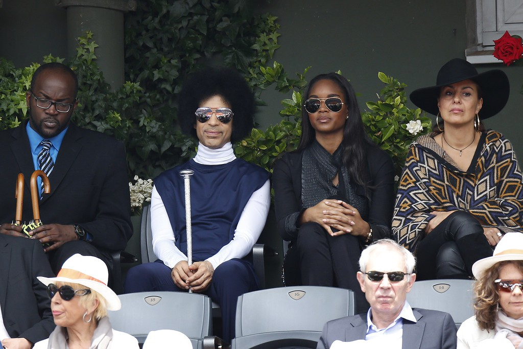 . US singer Prince attends the French tennis Open round of sixteen match between Spain\'s Rafael Nadal and Serbia\'s Dusan Lajovic at the Roland Garros stadium in Paris on June 2, 2014.  (KENZO TRIBOUILLARD/AFP/Getty Images)