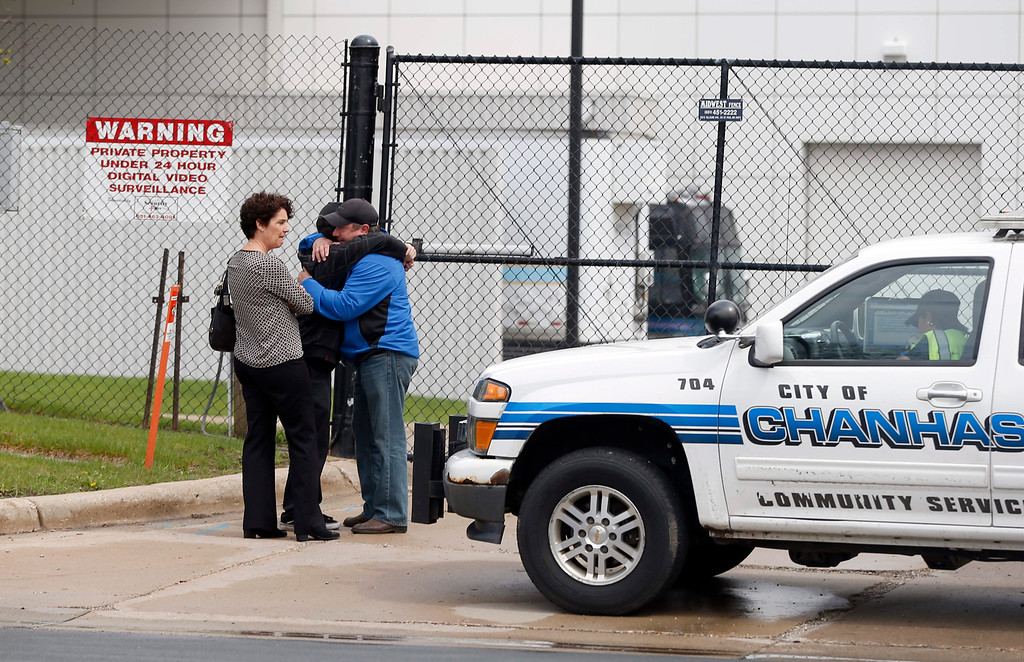 . People gather at an entrance to Paisley Park Studios, the home and studio of singer Prince on Thursday, April 21, 2016 in Chanhassen, Minn. Prince died at the home, Thursday, at the age of 57. (AP Photo/Jim Mone)