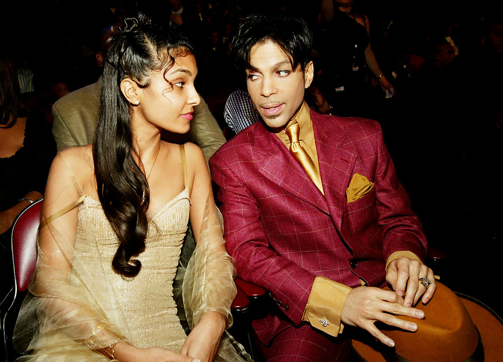 . HOLLYWOOD, CA - MARCH 6:  Singer Prince (R) and his wife Manuela Testolini sit in the audience at the 35th Annual NAACP Image Awards held at the Universal Amphitheatre, March 6, 2004 in Hollywood, California.  (Photo by Frank Micelotta/Getty Images)