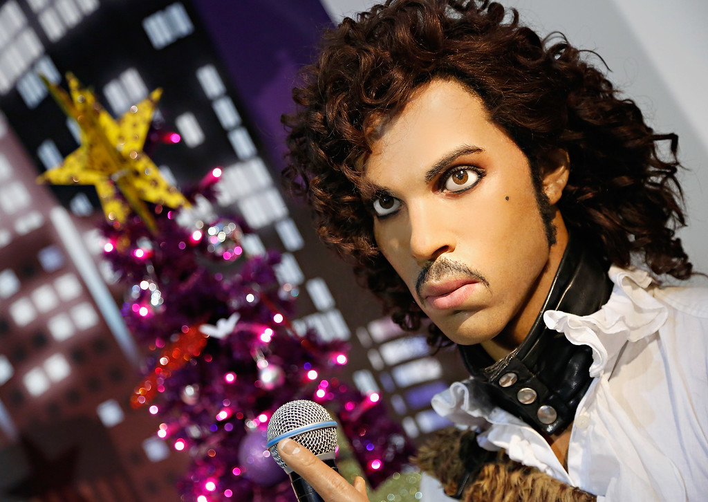 . NEW YORK, NY - DECEMBER 03:  Madame Tussauds wax figure of singer Prince  is on display as Madame Tussauds New York unveils celebrity themed holiday trees at Madame Tussauds New York on December 3, 2013 in New York City.  (Photo by Cindy Ord/Getty Images for Madame Tussauds)