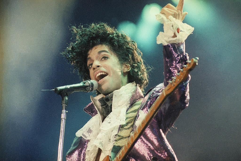 . Rock singer Prince performs at the Forum in Inglewood, Calif., during his opening show, Feb. 18, 1985. (AP Photo/Liu Heung Shing)