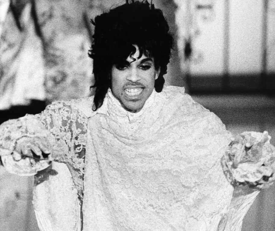 """. Rock star Prince is shown during his performance onstage at the Grammy Awards, Feb. 27, 1985 in Los Angeles. He won or shared three awards, including Best Rock Performance by a Duo or Group With Vocals, with his band Revolution, for \""""Purple Rain\""""; Best Album of Original Score for TV or Movies, \""""Purple Rain\""""; and Prince took Writing Rhythm and Blues honors for \""""I Feel For You,\"""" recorded by Chaka Khan. (AP Photo/Liu Heung Shing)"""