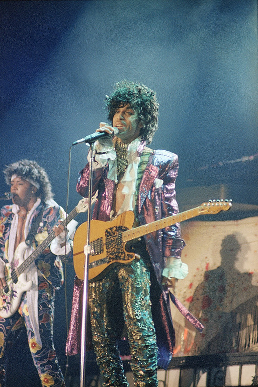 . Singer Prince is shown in concert in 1985, location unknown. Prince\'s publicist has confirmed that Prince died at his his home in Minnesota, Thursday, April 21, 2016. He was 57. (AP Photo)