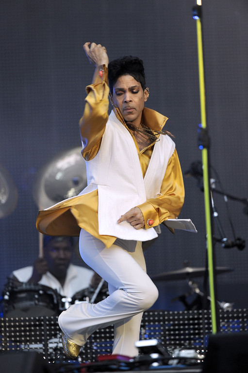 . US singer and musician Prince (born Prince Rogers Nelson) dances as he performs on stage at the Stade de France in Saint-Denis, outside Paris, on June 30, 2011. (BERTRAND GUAY/AFP/Getty Images)