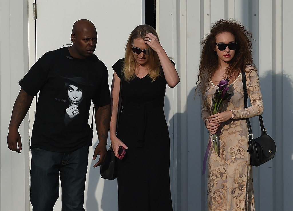 . Guests leave April 23, 2016 following a memorial service inside the Paisley Park compound of music legend Prince, who died suddenly at the age of 57, in Minneapolis, Minnesota.  Family, friends and musicians attended the service after the remains of Prince were cremated before being placed in a private location. (MARK RALSTON/AFP/Getty Images)