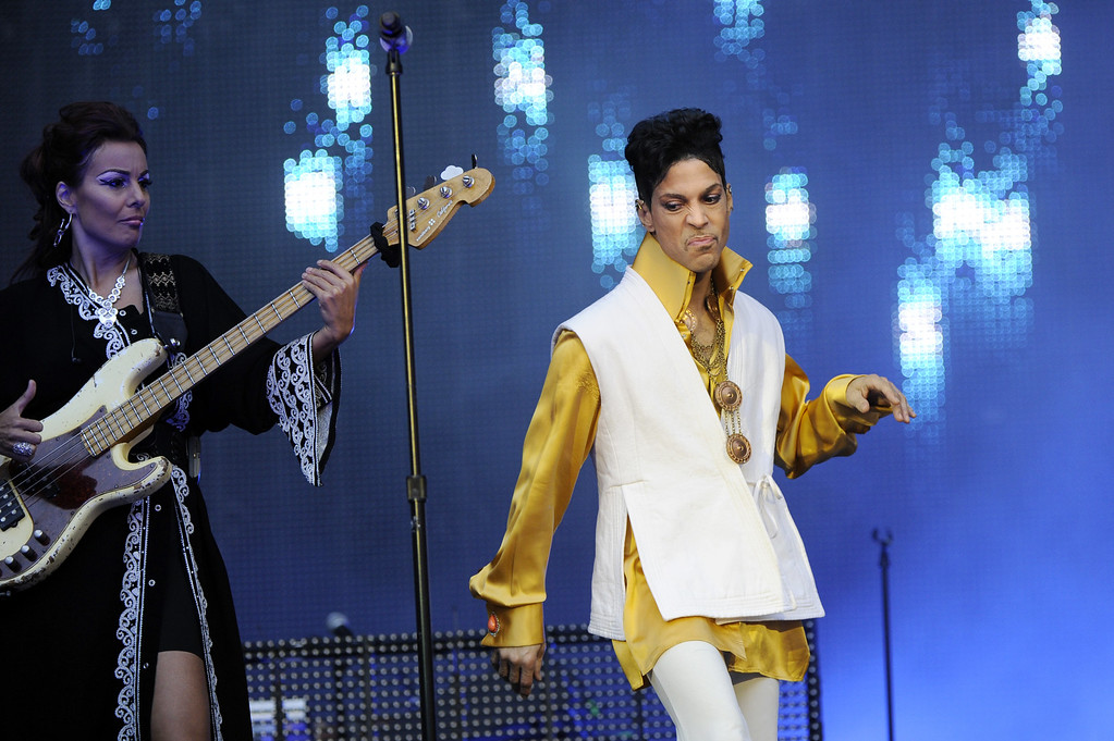 . US singer and musician Prince (born Prince Rogers Nelson) and Danish bassist Ida Nielsen (L) perform on stage at the Stade de France in Saint-Denis, outside Paris, on June 30, 2011. (BERTRAND GUAY/AFP/Getty Images)