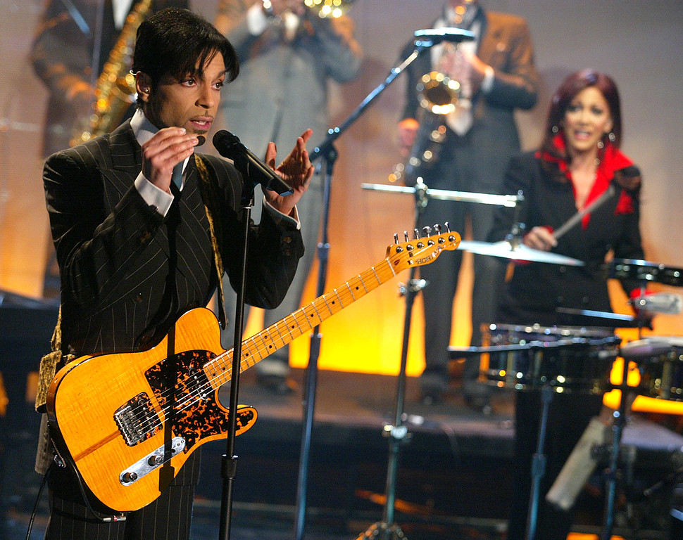 """. Prince, with Sheila E, at \""""The Tonight Show with Jay Leno\"""" at the NBC Studios in Burbank, Ca. Friday, Dec. 13, 2002. Photo by Kevin Winter/ImageDirect."""
