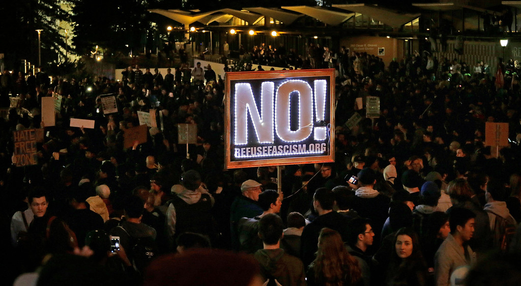 . Protestors against a scheduled speaking appearance by polarizing Breitbart News editor Milo Yiannopoulos fill Sproul Plaza on the University of California at Berkeley campus on Wednesday, Feb. 1, 2017, in Berkeley, Calif. The event was canceled out of safety concerns after protesters hurled smoke bombs, broke windows and started a bonfire. (AP Photo/Ben Margot)