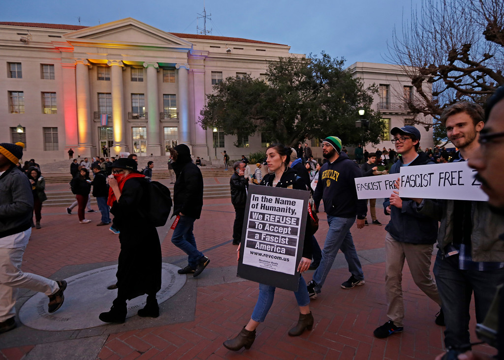 . People march in front of Sproul Hall to protest the appearance of Breitbart News editor Milo Yiannopoulos on Wednesday, Feb. 1, 2017, in Berkeley, Calif. The University of California at Berkeley is bracing for major protests Wednesday against Milo Yiannopoulos, a polarizing Breitbart News editor, on the last stop of a tour aimed at defying what he calls an epidemic of political correctness on college campuses. (AP Photo/Ben Margot)