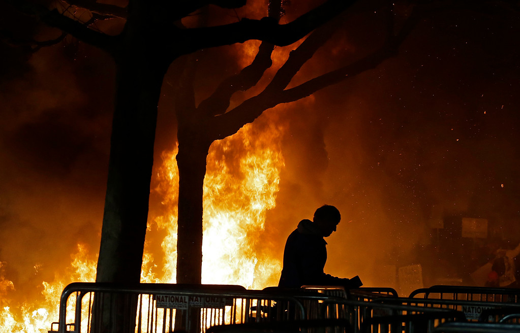 . A bonfire set by demonstrators protesting a scheduled speaking appearance by Breitbart News editor Milo Yiannopoulos burns on Sproul Plaza on the University of California at Berkeley campus on Wednesday, Feb. 1, 2017, in Berkeley, Calif. The event was canceled out of safety concerns after protesters hurled smoke bombs, broke windows and started a bonfire. (AP Photo/Ben Margot)