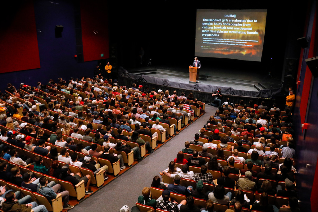". Milo Yiannopoulos, the polarizing Breitbart News editor, speaks at California Polytechnic State University as part of his ""The Dangerous Faggot Tour\"" of college campuses, Tuesday, Jan. 31, 2017, in San Luis Obispo, Calif.  UC Berkeley officials canceled a talk by Yiannopoulos after protesters threw smoke bombs and flares at a building on campus. The violence at UC Berkeley�s student union building happened ahead of Yiannopoulos\' Wednesday evening event.  (David Middlecamp/The Tribune (of San Luis Obispo) via AP)"