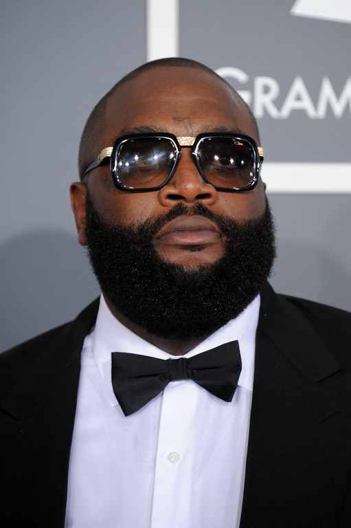 . Rick Ross arrives at the 55th annual Grammy Awards on Sunday, Feb. 10, 2013, in Los Angeles.  (Photo by Jordan Strauss/Invision/AP)
