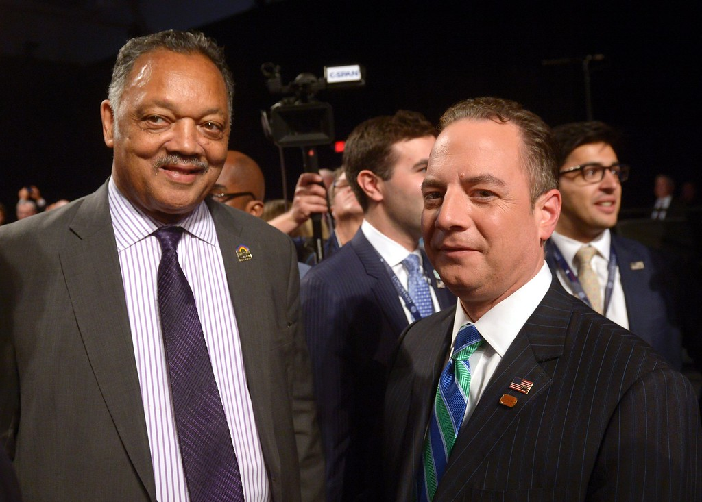 . Jesse Jackson (L) speaks with Chairman of the Republican National Committee Reince Priebus before the vice presidential debate at Longwood University in Farmville, Virginia on October 4, 2016. (SAUL LOEB/AFP/Getty Images)