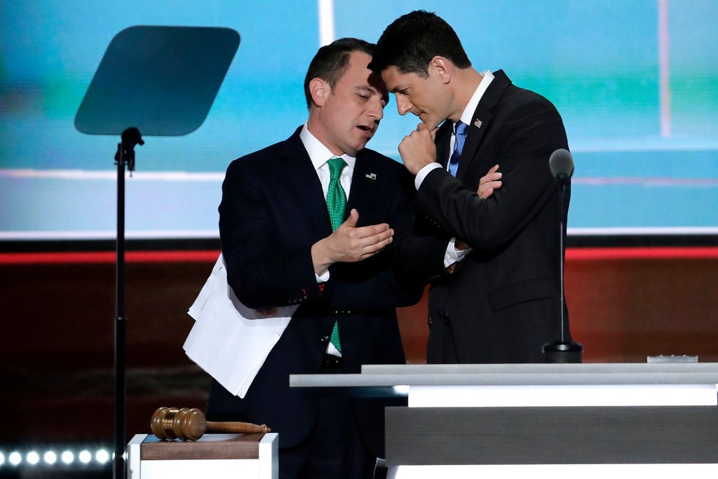 . Speaker Paul Ryan of Wisconsin and Reince Priebus, Chairman of the Republican National Committee talk while Alaska recounts their votes during the second day of the Republican National Convention in Cleveland, Tuesday, July 19, 2016. (AP Photo/J. Scott Applewhite)