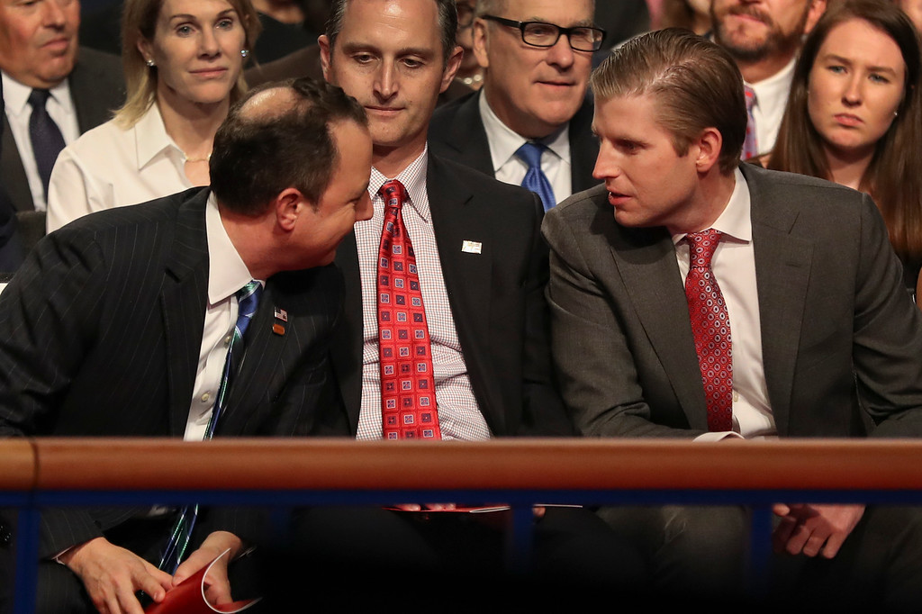 . Republican National Committee Chairperson Reince Priebus talks with Eric Trump, son of Republican presidential candidate Donald Trump, before the debate between Republican vice-presidential nominee Gov. Mike Pence and Democratic vice-presidential nominee Sen. Tim Kaine at Longwood University in Farmville, Va., Tuesday, Oct. 4, 2016. (Joe Raedle/Pool via AP)