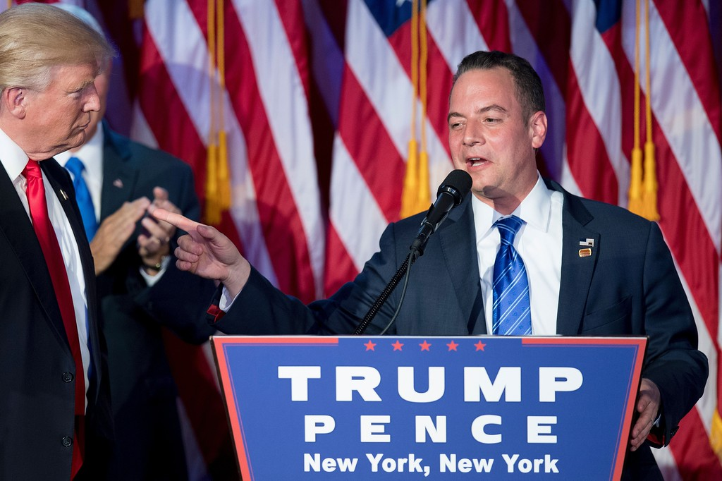 . Chairman of the Republican National Committee (RNC) Reince Priebus (R) gestures to Republican presidential elect Donald Trump (L) during election night at the New York Hilton Midtown in New York on November 9, 2016. Trump has chosen Republican Party Chairman Reince Priebus as his White House chief of staff.  (JIM WATSON/AFP/Getty Images)