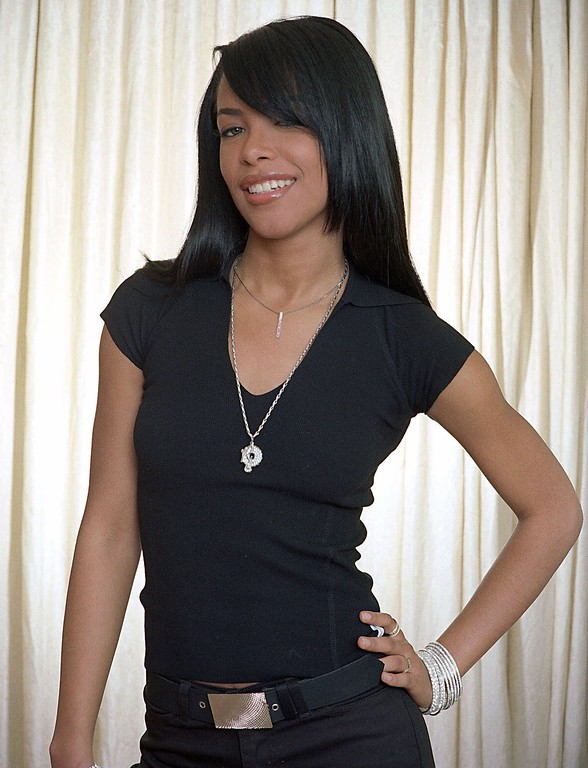 ". Singer Aaliyah poses for a photo in New York, May 9, 2001. Her new album ""Aaliyah,\"" released by Blackground/Virgin, features the imprint of regular Aaliyah contributors Timbaland and Missy \""Misdameanor\"" Elliott. (AP Photo/Jim Cooper)"