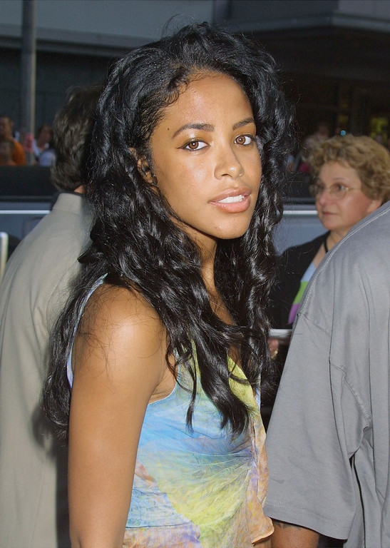 ". Singer Aaliyah attends the world premiere of the film ""Planet of the Apes\"" July 23, 2001 at the Ziefield Theatre in New York City. (Photo by George De Sota/Getty Images)"