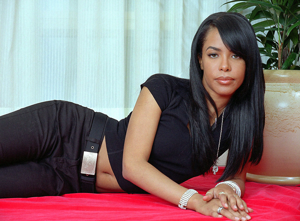 . FILE - This May 9, 2001 file photo shows R&B singer and actress Aaliyah posing for a photo in New York. Aaliyah was killed with eight others in a plane crash in the Bahamas on August 25, 2001. She was 22. (AP Photo/Jim Cooper, file)