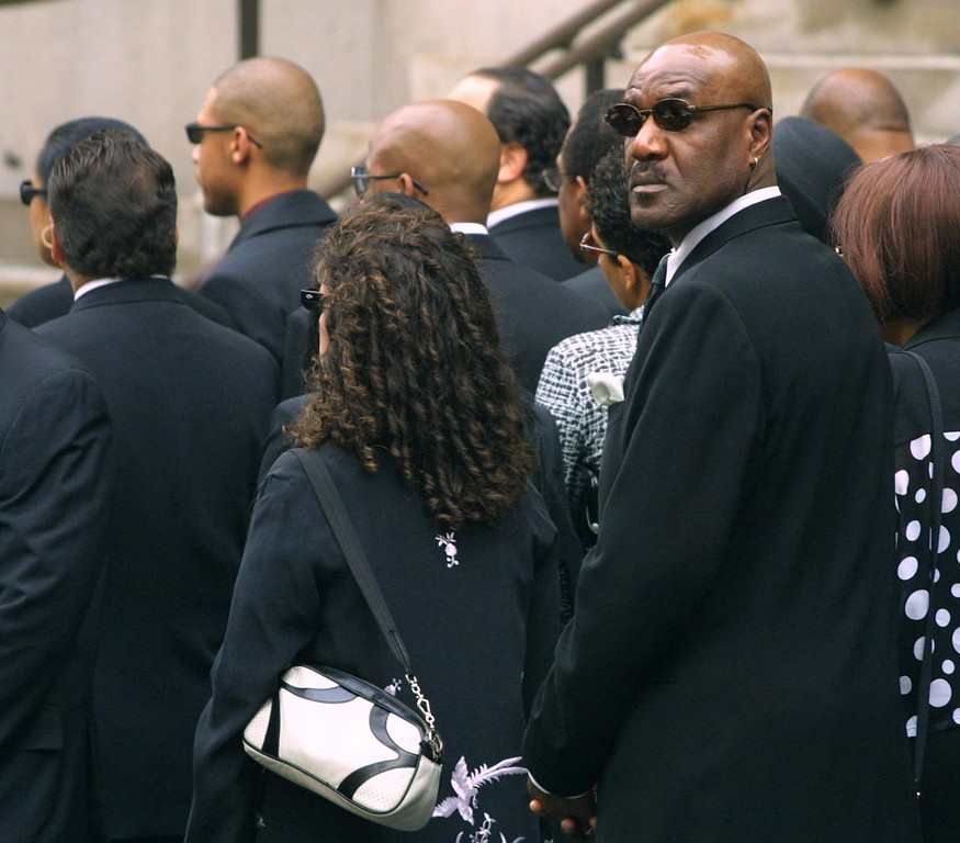 . Actor Delroy Lindo, right, joins a group of mourners at the funeral of R&B vocalist Aaliyah in New York, Friday, Aug. 31, 2001. The 22-year-old singer-actress died Saturday in a plane crash in the Bahamas, where she had been shooting a music video. (AP Photo/Stuart Ramson)