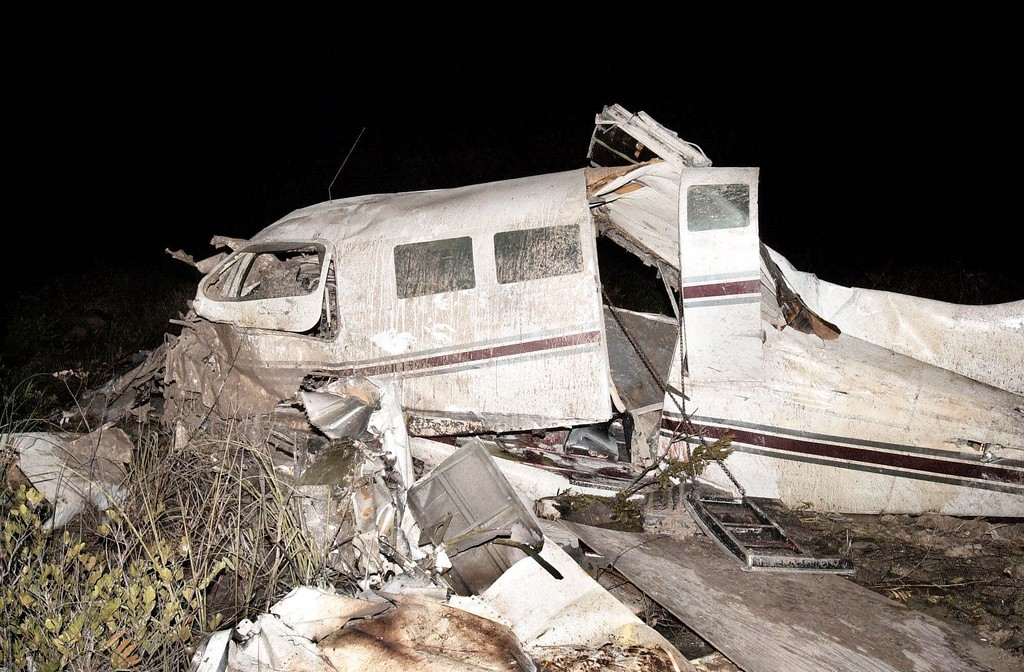 . A twin engine Cessna carrying recording artist and movie star Aaliyah and her film crew crashed shortly after takeoff from Marsh Harbour International Airport, in the Bahamas, Saturday Aug. 25, 2001. Aaliyah and seven others died at the scene.  (AP Photo/Tim Aylen)