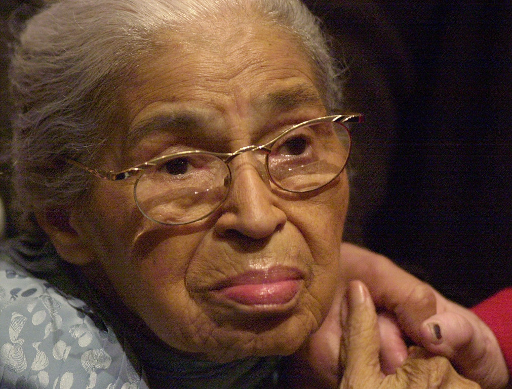 . FILE - In this Saturday, Dec. 1, 2001, file photo, civil rights pioneer Rosa Parks holds the hand of a well-wisher at a ceremony honoring the 46th anniversary of her arrest for civil disobedience, at the Henry Ford Museum in Dearborn, Mich. Parks� archive of letters, writings, personal notes and photographs has been fully digitized by the Library of Congress and is now available online. The library announced Wednesday, Feb. 24, 2016, that the collection of about 10,000 items belonging to Parks is available to the public. (AP Photo/Paul Warner, File)