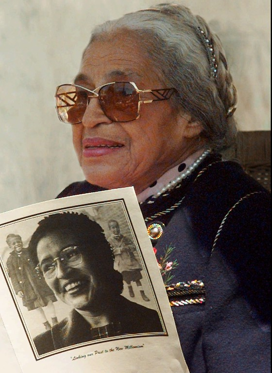 . Rosa Parks, 84, holds a program from the Rosa Park Elementary School dedication during the ceremony Thursday April 24, 1997, in San Francisco. The cover of the program displays a photograph of Parks when she was a younger civil rights activist. Parks is known for her act of defiance on a Montgomery, Ala., bus in 1955 when she refused to move to the back of the bus.(AP Photo/Lacy Atkins)