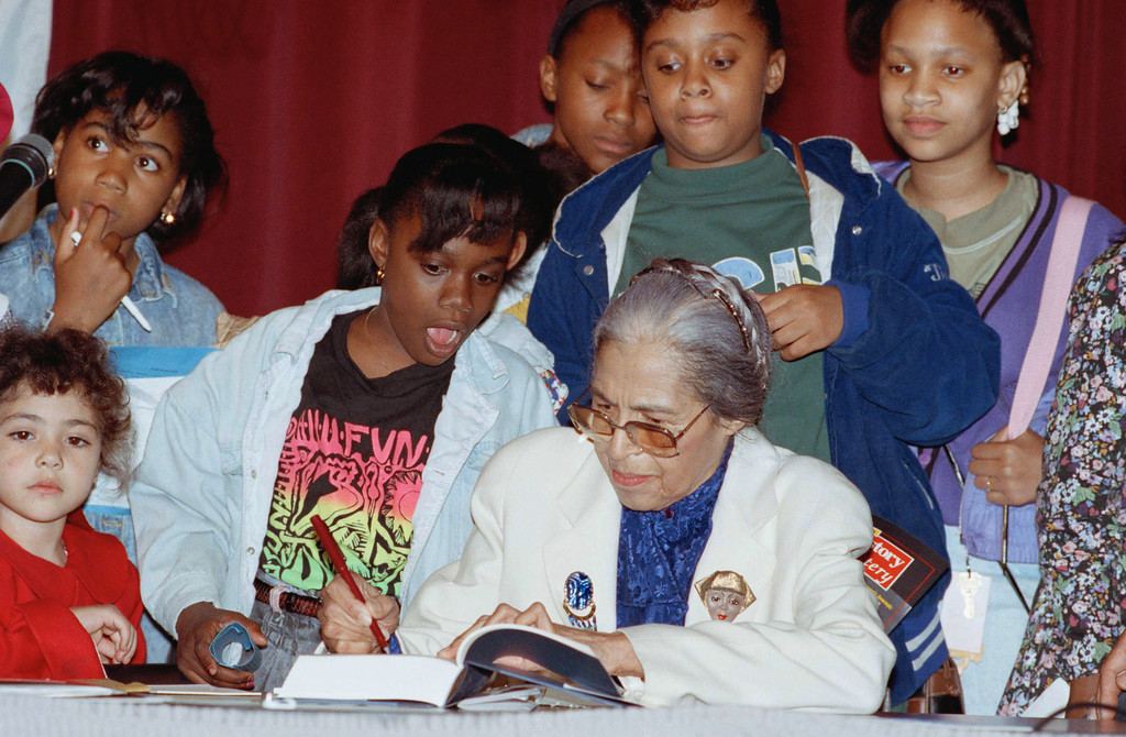 . Rosa Parks, who ignited the civil rights movement by refusing to give up her seat on an Alabama bus in 1955, signs autographs after speaking at the Ford Hall Forum on May 6, 1991 in Boston. Parks was honored by the forum with its Annual First Amendment Award for her commitment to free expression. (AP Photo/Julia Malakie)