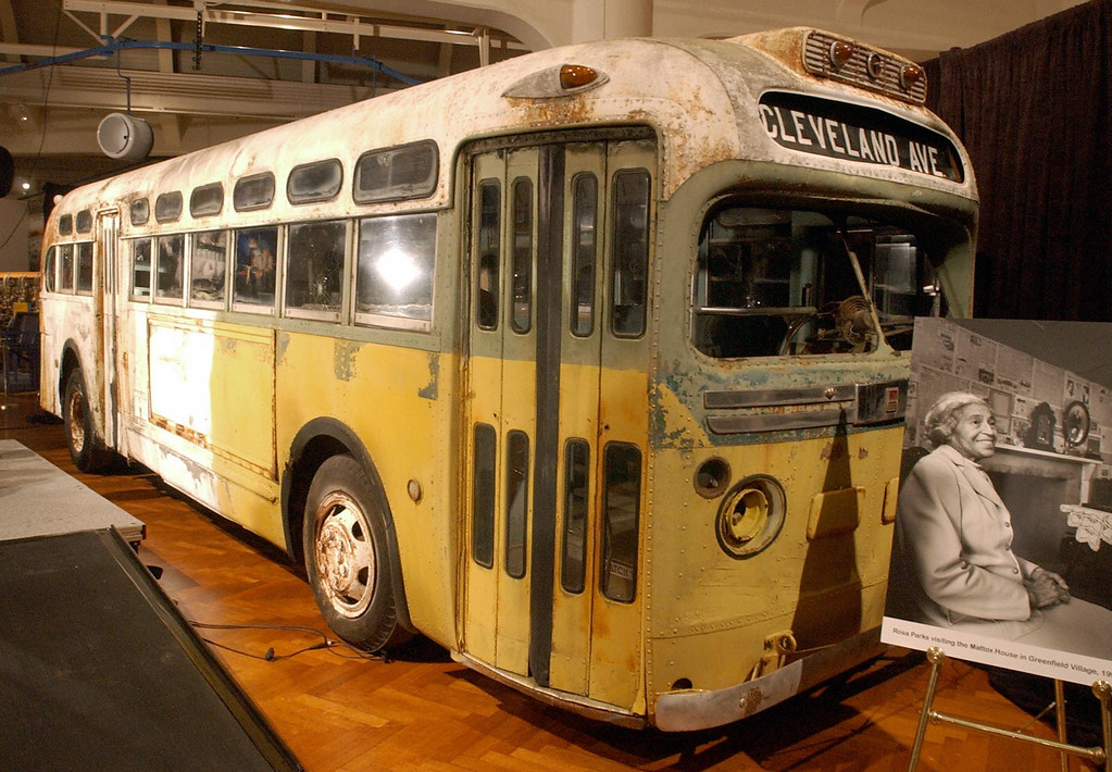 . This file photo dated 01 December, 2001 shows the bus from Mobile, Alabama that US civil rights legend Rosa Parks (pictured at R) was arrested abroad, during a ceremony at the Henry Ford Museum in Dearborn, Michigan commemorating the 46th anniversary of the event. It was reported 24 October, 2005 that Rosa Parks, who helped spark the civil rights movement when she refused to give up her bus seat to a white man in 1955 on this bus, has died at the age of 92.    (JEFF KOWALSKY/AFP/Getty Images)