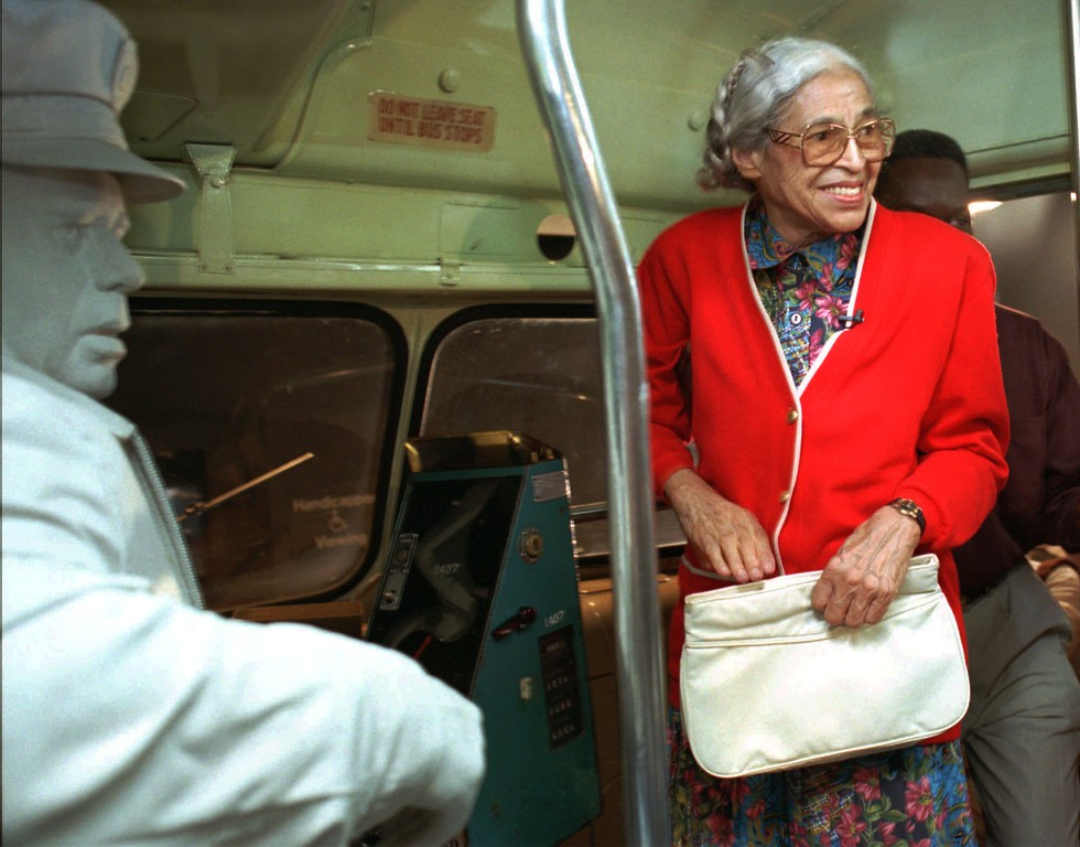 ". Rosa Parks visits an exhibit illustrating her bus ride of December, 1955 at the National Civil Rights Museum in Memphis, Tenn., Saturday, July 15, 1995.  Parks visited around the city to inaugurate her three-week ""Freedom Ride\"" throughout the country.  (AP Photo/Troy Glasgow)"