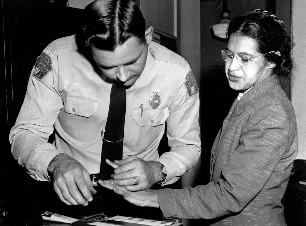 . Rosa Parks is fingerprinted by police Lt. D.H. Lackey in Montgomery, Ala., Feb. 22, 1956, two months after refusing to give up her seat on a bus for a white passenger on Dec. 1, 1955.  She was arrested with several others who violated segregation laws. Parks\' refusal to give up her seat led to a boycott of buses by blacks in Dec. 1955, a tactic organized by the Rev. Dr. Martin Luther King Jr., which ended after the U.S. Supreme Court deemed that all segregation was unlawful, Dec. 20, 1956. (AP Photo/Gene Herrick)