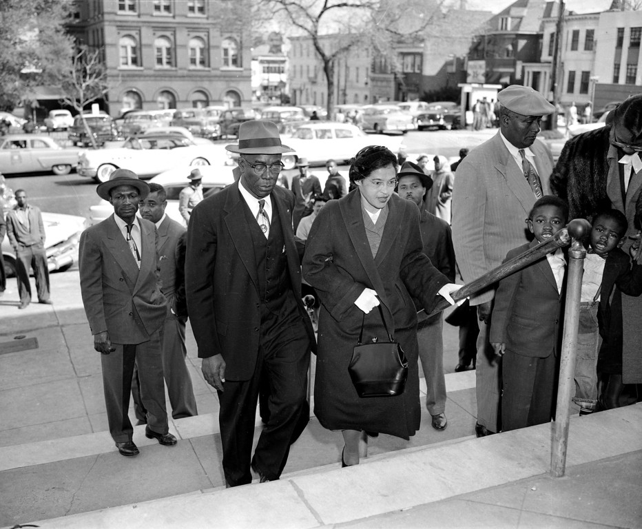 . Rosa Parks is escorted by E.D. Nixon, former president of the Alabama NAACP, on arrival at the courthouse in Montgomery March 19, 1956 for the trial in the racial bus boycott.  Mrs. Parks was fined $14 on Dec. 5 for failing to give up her seat for a white passenger on a city bus.  The bus boycott started on the day she was fined.  There were 91 other defendants.  (AP Photo/Gene Herrick)