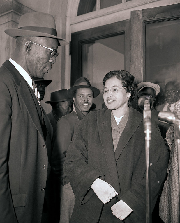 . Mrs. Rosa Parks and E.D. Nixon, left, former president of the Alabama NAACP, arrive at court in Montgomery March 19, 1956 for the trial in the racial bus boycott.  Mrs. Parks was fined $14 on Dec. 5 for failing to move to the segregated section of a city bus.  The boycott started on the day she was fined.  There were 91 other defendants. (AP Photo/Gene Herrick)