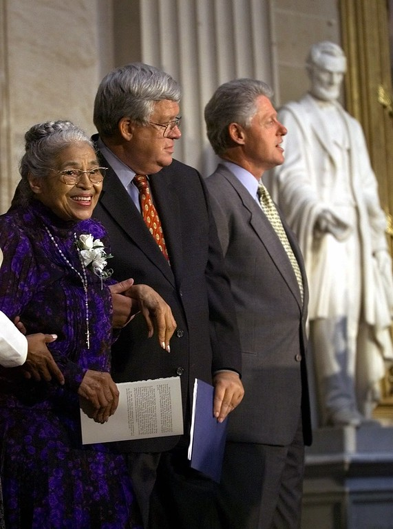 . Rosa Parks, left, is joined by President Clinton, right, and Speaker of the House Dennis Hastert in a Capitol Hill ceremony where Mrs. Parks was honored with the Congressional Gold Medal Tuesday, June 15, 1999, in Washington. President Clinton last month signed a bill bestowing Congress\' highest recognition on the 86-year-old Mrs. Parks. The statue seen behind is of President Abraham Lincoln. (AP Photo/Khue Bui)