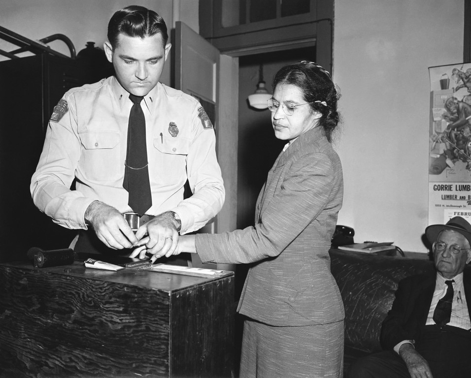 . Rosa Parks, whose refusal to move to the back of a bus, touched off the Montgomery bus boycott and the beginning of the civil rights movement, is fingerprinted by police Lt. D.H. Lackey in Montgomery, Ala., Feb. 22, 1956. She was among some 100 people charged with violating segregation laws. (AP Photo/Gene Herrick)