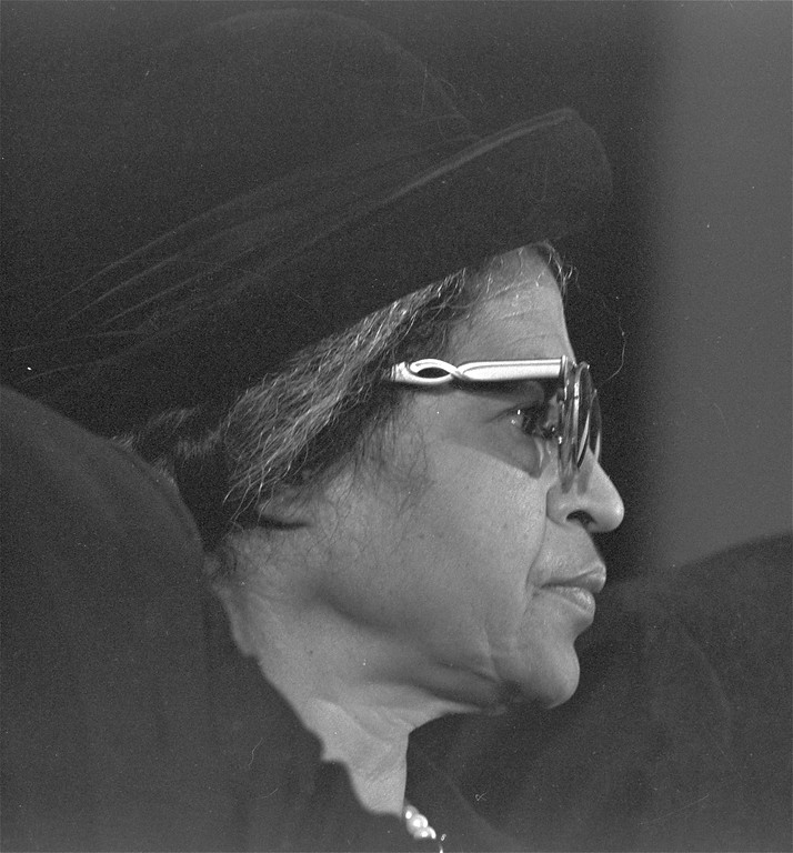 . Rosa Parks, who refused to move to the back of the bus and touched off the civil rights movement in Montgomery, Alabama in 1955, stands during services in Atlanta commemorating the birthday of Dr. Martin Luther King, Jr., Jan. 15, 1969.  Dr. King was pastor of a Montgomery church at the time.  (AP Photo/STF)